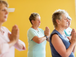 a group of mature aged ladies practising yoga